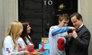 Prime minister David Cameron buys a remembrance poppy.