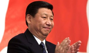 File photo of Chinese Vice President Xi Jinping applauding in Moscow