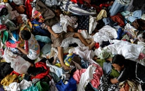 Mount Merapi: Refugees rummage through the second-hand clothes in Yogyakarta