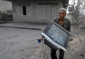 Mount Merapi: An elderly Indonesian villager salvages belongings escaping the erupition