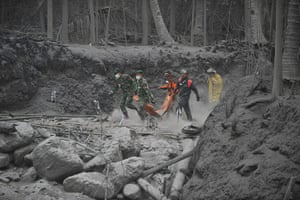 Mount Merapi: Rescue teams walk on the dry hot mud to evacuate victims of Mount Merapi