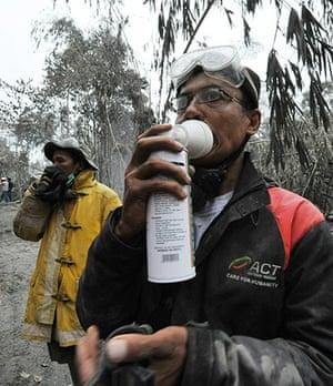 Mount Merapi: A member of a rescue team wear inhales oxygen