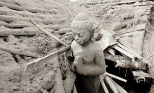 Mount Merapi: A Buddhist statue is covered with mountain ash
