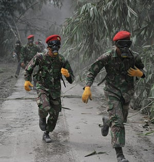 Mount Merapi: Army special forces wearing masks prepare to evacuate the victims