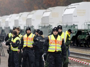 Anti-nuclear protests: Police officers stand in front of containers carrying nuclear waste