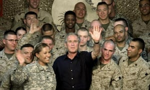 George Bush, pictured here with US marines in Anbar province, Iraq