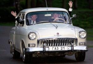 George W Bush: 8 May 2005: President Bush and Russian President Vladimir Putin wave