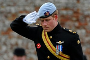 Wootton Bassett : Prince Harry salutes after laying a cross of remembrance