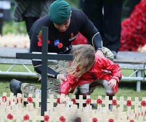 Wootton Bassett : Ram Pattern holds his daughter Melanie Pattern before they laid a poppy
