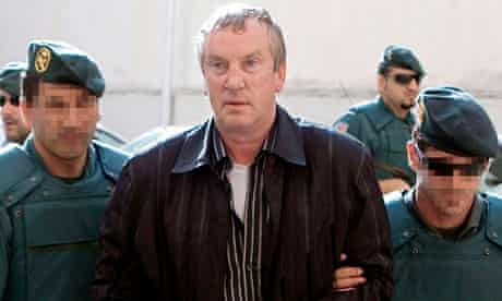 WikiLeaks cables: Gennady Petrov is escorted by police after his arrest in Calvia, Spain, in 2008