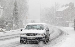 Snow today: A motorist drives through heavy snow in Manchester