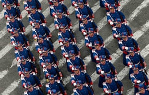 24 hours in pictures: Soldiers march during a military parade to celebrate Romania's National Day