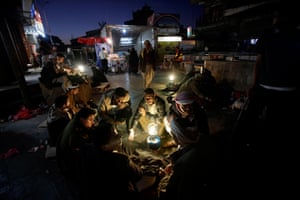 24 hours in pictures: Yemeni customers gather around vendors selling Qat