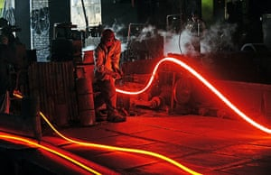 24 hours in pictures: A Steel worker with molten steel at Ittehad Steel Mill Islamabad