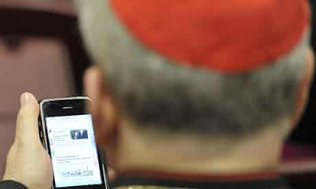 An unidentified cardinal reads news on a mobile device during a day of reflection at the Vatican