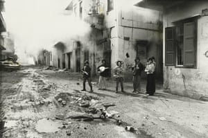 Photography Books: Phalangists with the body of a Palestinian girl, Beirut, by Don McCullin