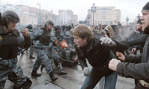 Football fans clash with riot police in central Moscow during a rally in memory of Yegor Sviridov