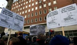 Julian Assange Trial: Protestors hold placards as they demonst