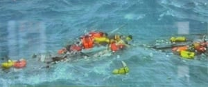Christmas Island: Rescuers swim out to the victims on Christmas Island
