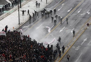 Riots in Athens: Riot police clash with protesters in Athens