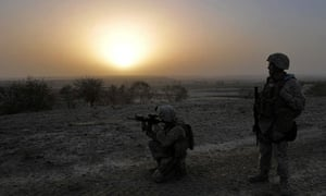 A US marine looks through the scope of his rifle during a patrol in Helmand province, Afghanistan
