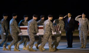 Barack Obama salutes the coffin of a US soldier killed in Afghanistan, October 2009