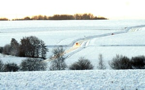 Winter Weather Europe: Cars drive on a snowed up road in Godewaersvelde, northern France