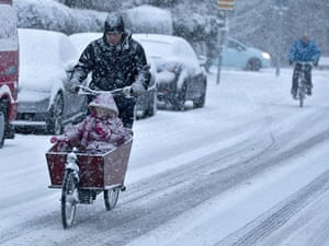Winter Weather Europe: Cyclist ride through the snow in Haarlem, Netherlands