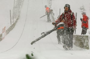 Winter Weather Europe: Workers use blowers to remove extra snow during ski jumping in Engelberg