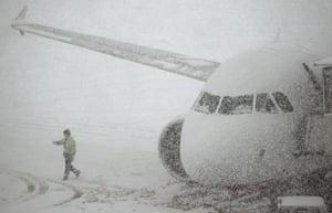 Winter Weather Europe: A worker walks past a plane parked at Zurich airport in Kloten