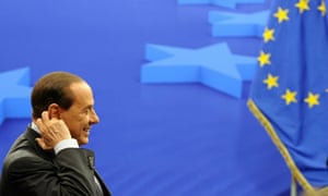 Silvio Berlusconi at the EU summit where embarrassing tweets about him appeared on giant screens