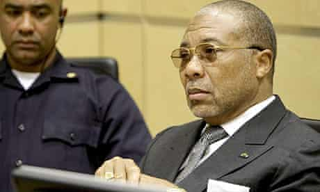 Former Liberian president Charles Taylor sits in the international criminal court, The Hague