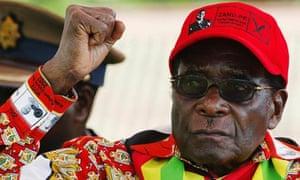 Zimbabwean President Robert Mugabe raise