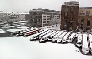 Snow: Snow collects on Ice Wharf Marina