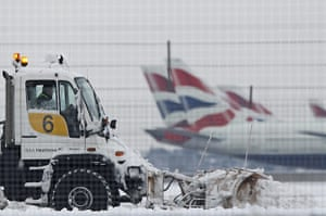 Cold weather continues: A snow plough is driven by a worker at Heathrow Airport in west London