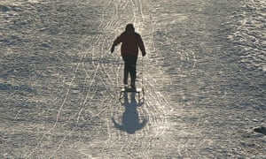 Cold weather continues: A boy pulls his sledge back up a hill at Dunham Massey park in Cheshire