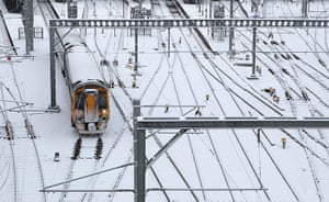 Cold weather continues: A train travels over snow-covered tracks as it leaves Waverley Station