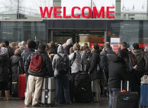 Cold weather continues: Airline passengers queue to enter Terminal 3 at Heathrow Airport
