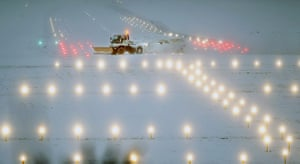 Cold weather continues: Snow ploughs work to clear snow and ice on a runway at Edinburgh Airport