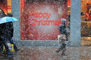 Cold weather continues: Christmas shoppers in London's Oxford Street as winter weather returns