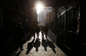 Year in Business: City worker casts shadows in Leadenhall Market in the City of London