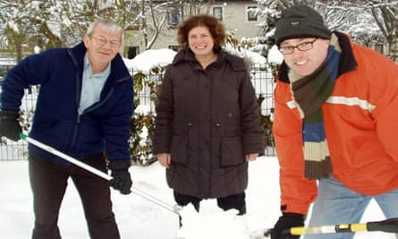 Jimmy Clark, Shona McGregor and Paul Edie shovel the snow at Ford's Road Care Home in Edinburgh