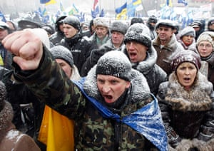 24 hours in pictures: Demonstrators hold a rally to protest in central Kiev