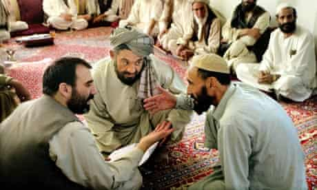 Ahmed Wali Karzai, the Afghan president's half-brother, speaks with tribal leaders