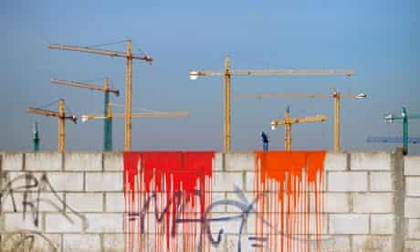 Cranes on an unfinished construction site on the outskirts of Madrid, Spain.