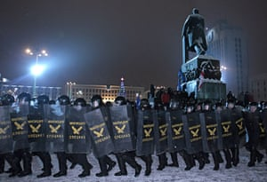 Belarus election violence: Riot police officers move to form a line to block the road