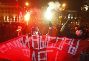 Belarus election violence: Opposition protesters light flares and shout slogans as they rally