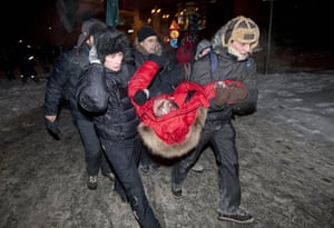 Belarus election violence: Supporters carry presidential candidate Vladimir Neklyayev
