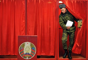 Belarus election violence: A Belarus soldier leaves a polling booth to cast his vote