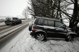 snow continues in uk: A car is left abandoned